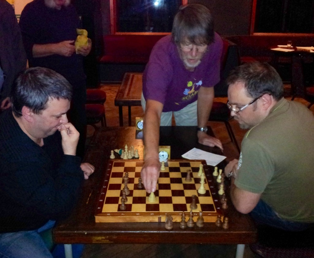 Dave Shapland's (right) game against Clive Edwards (left) was the last to finish and decided a close match. At the end the kibbitzers hovered to help the players anaylse a complicated struggle and Pete Leonard (centre) demonstrated a forced win that Dave had been unable to compute during the game