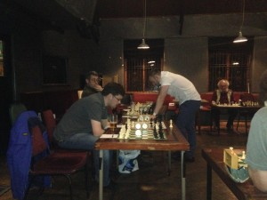 Matthew Parsons (front left) and Martin Syrett (back left) both managed to take draws off  Matty. Martin could even have won his game at the end of the evening.