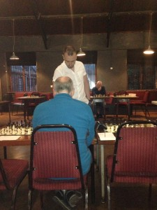 Matthew Webb (standing) took on 10 players at once (including Andy Leatherbarrow - seated) at the Trades Club on Monday night.