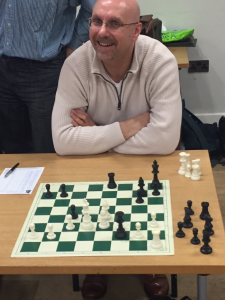 He had every reason to look pleased! Andrew Clarkson drew the first Grand Master blood of the afternoon